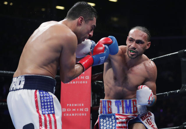 Keith Thurman, right, punches Josesito Lopez during the fifth round of a welterweight championship boxing match Saturday, Jan. 26, 2019, in New York. Thurman won the fight. (AP Photo/Frank Franklin II)