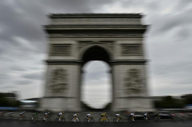 'Love story': Chris Froome (centre in yellow) rides past the Arc de Triomphe on the 2017 Tour de France