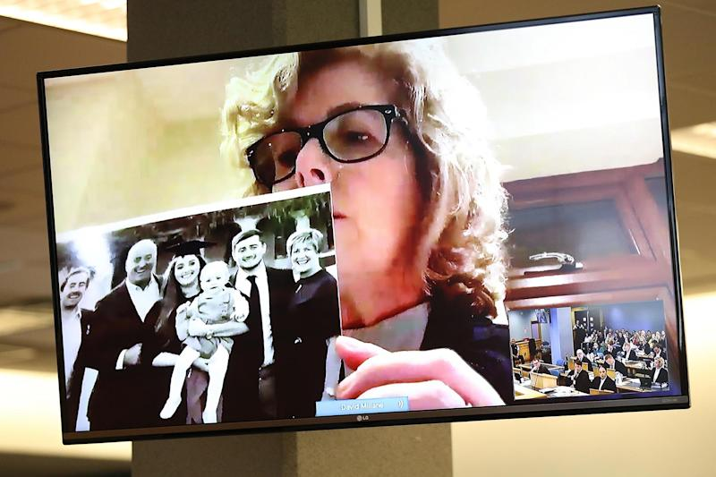 Gillian Millane holds a family photograph during her televised victim impact statement from her home in the UK (Getty Images)