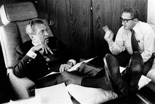 In this June 25, 1974, photo released by the White House, President Richard Nixon listens to his Secretary of State Dr. Henry Kissinger aboard the plane that brought the U.S. president to Belgium. Within two months Nixon had resigned, and in June 1975, the feisty ex-President defended his shredded legacy and shady Watergate-era actions in grand jury testimony that he thought would never come out. On Thursday, Nov. 10, 2011, it did. (AP Photo/White House Photo, Ollie Akins)