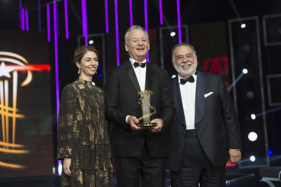 Bill Murray poses with his Tribute Award between Sofia Coppola and Francis Ford Coppola during the Marrakech International Film Festival, on December 4, 2015. (Photo by Stephane Cardinale/Corbis via Getty Images)