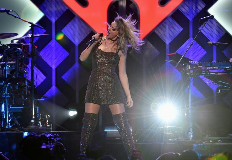 Taylor Swift -- seen here performing in New York in December 2019 -- is vying for a number of top Grammys at the 2021 gala