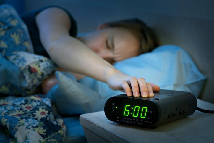 Don't feel guilty hitting the snooze button. [Photo credit: Elenathewise | Getty Images]