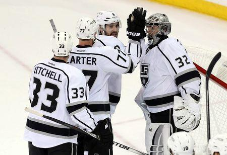 Jun 9, 2014; New York, NY, USA; Los Angeles Kings goalie Jonathan Quick (32) is congratulated by his teammates after game three of the 2014 Stanley Cup Final against the New York Rangers at Madison Square Garden. The Kings won 3-0. Mandatory Credit: Adam Hunger-USA TODAY Sports