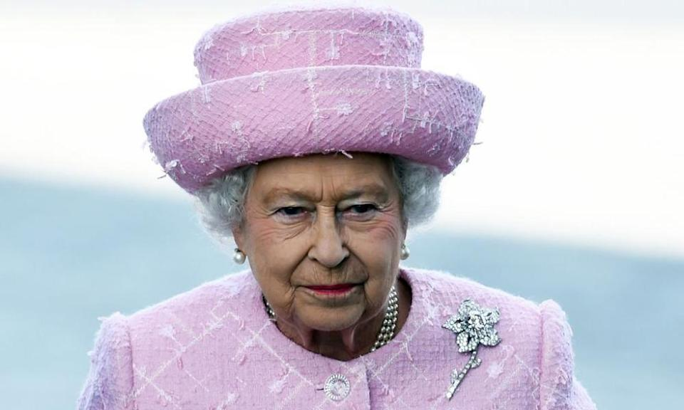 The Queen wearing the brooch, which features a 54-carat pink diamond found at the Williamson mine and presented to her as a wedding present.