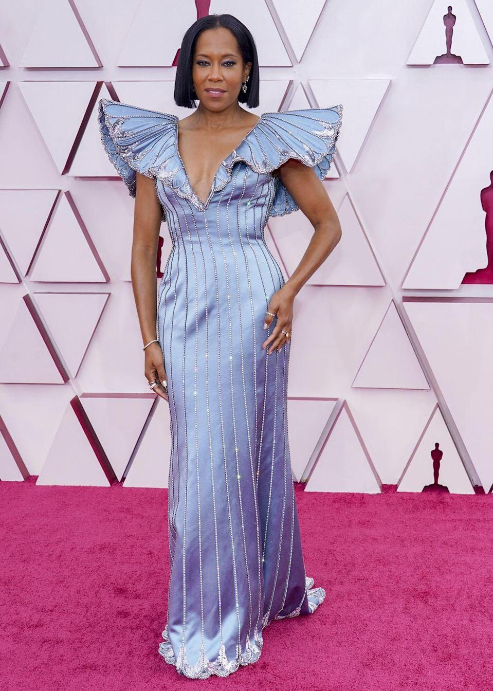 <p>Regina King never fails to land on every best dressed list, and the 2021 Academy Awards was no different. The actress worked with her stylist duo, Wayman and Micah, on this beautiful embellished Louis Vuitton gown with a dramatic cape detail in a Cinderella blue. According to the team, the dress took over 140 hours to make and was embroidered with over 62,000 sequins and 4,000 crystals.</p>