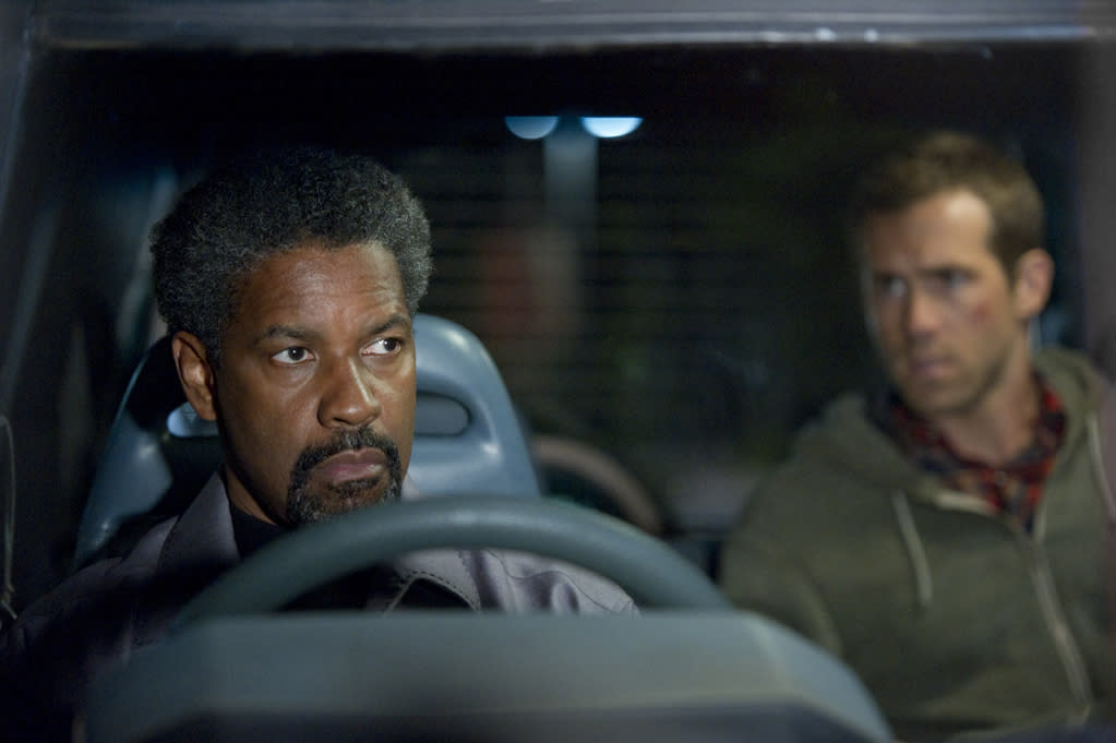 """Denzel Washington and Ryan Reynolds in Universal Pictures' <a href=""""http://movies.yahoo.com/movie/safe-house-2012/"""">Safe House</a> - 2012"""