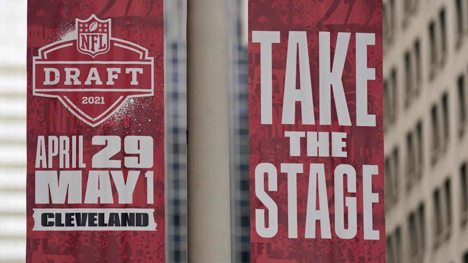 Banners hang in downtown Cleveland announcing the NFL draft, Saturday, April 24, 2021. After going all virtual in 2020 due to the COVID-19 pandemic, the three-day draft, which has grown into one of America's biggest, non-game sporting events, returns with an outdoor event and thousands of fans who will be separated by their loyalties — and whether they've been vaccinated. Back on the road in Cleveland, this draft will be unlike any other.(AP Photo/Tony Dejak)