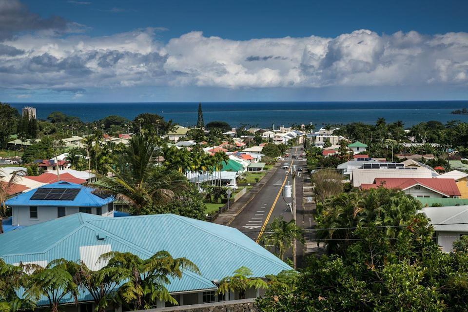 """<p>The town of Hilo is nestled along the <a href=""""https://www.tripadvisor.com/Tourism-g60583-Hilo_Island_of_Hawaii_Hawaii-Vacations.html"""" rel=""""nofollow noopener"""" target=""""_blank"""" data-ylk=""""slk:Big Island's largest harbor"""" class=""""link rapid-noclick-resp"""">Big Island's largest harbor</a> and boasts beautiful waterfalls with stellar views. Just south of the tropical retreat is Volcanoes National Park, home to some of the most active volcanoes in the world.</p>"""