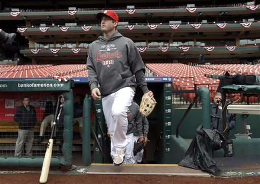 St. Louis Cardinals third baseman David Freese walks out of the Cardinals' dugout at the start of baseball practice Saturday, Oct. 6, 2012, in St. Louis. The Cardinals and Washington Nationals are scheduled to play Game 1 in the National League division series on Sunday. (AP Photo/Jeff Roberson)