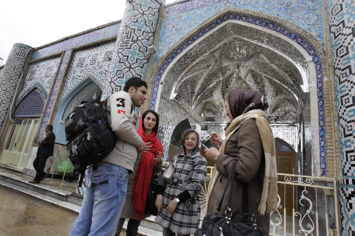 In this picture taken on Thursday, Feb. 16, 2012, Iranian Jews talk at the courtyard of the shrine of biblical prophet Daniel, in the city of Susa, some 450 miles ( 750 kilometers) southwest of the capital Tehran, Iran. All but lost amid the heated talk about a possible Israeli attack on Iran's suspect nuclear program are the thousands of Jews who live in the Islamic Republic and could be caught in the middle. (AP Photo/Vahid Salemi)