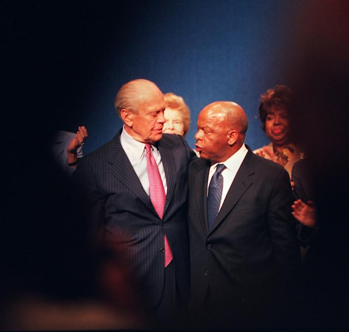 President Gerald Ford, left, and Congressman John Lewis, right, embrace after receiving Profiles in Courage awards at the JFK Library on May 21, 2001. Congressman John Lewis was cited for lifetime achievement. (Photo: Joanne Rathe/The Boston Globe via Getty Images)