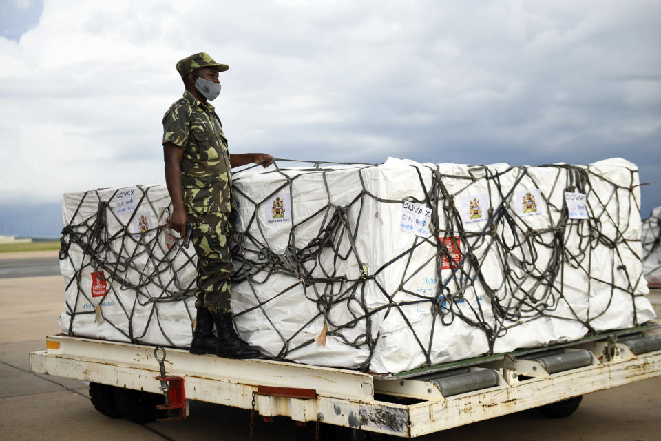 A Malawian policeman guards AstraZeneca COVID-19 vaccines after the shipment arrived at the Kamuzu International Airport in Lilongwe, Malawi, Friday March 5, 2021. The country is the latest in Africa to receive vaccines in a fight against COVID-19. (AP Photo/Thoko Chikondi)