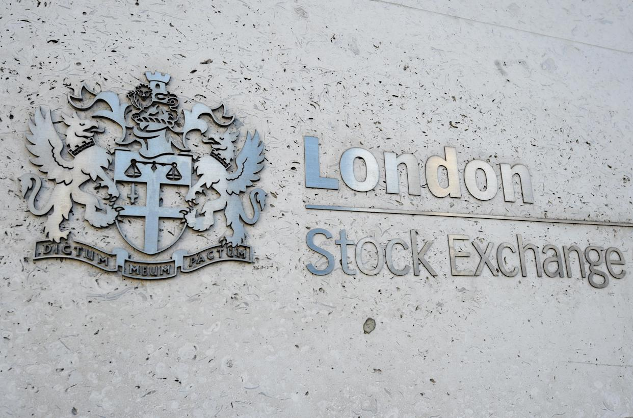 File photo dated 6/2/2018 of a view of the London Stock Exchange sign in the City of London. The London Stock Exchange Group (LSEG) upped its full-year dividend on Friday as it managed to increase profits during Covid-19. Pre-tax profit rose to �685 million in 2020, up from �651 million a year earlier, on revenue of �2.1 billion, up 3%. Issue date: Friday March 5, 2021.