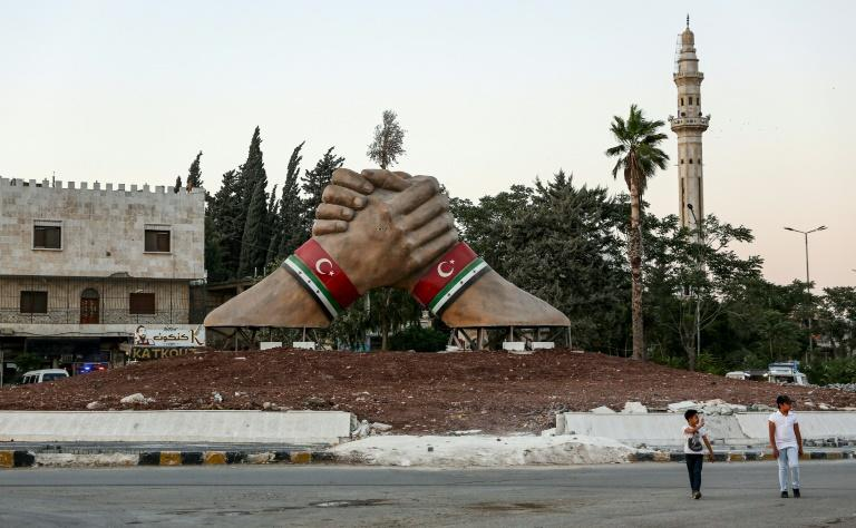 A sculpture of two hands with both the Syrian rebel and Turkish flags shows Ankara's influence in the Aleppo province of northern Syria (AFP Photo/Nazeer Al-khatib)