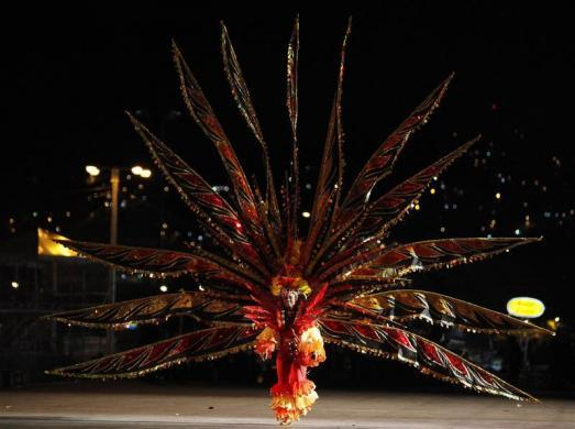 LaToya DeLeon presents her creation titled Heat Wave-The Last Of The Phenomenal Havoc, on the stage at Queen's Park Savannah during the preliminaries of the King and Queen of Carnival competition in Port of Spain, February 9, 2012.