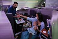 A couple and their children dine in business class