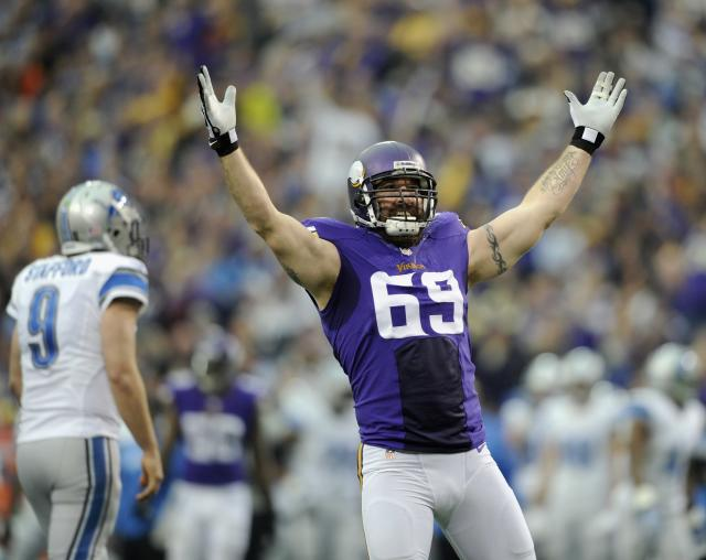 MINNEAPOLIS, MN - DECEMBER 29: Jared Allen #69 of the Minnesota Vikings celebrates a sack as Matthew Stafford #9 of the Detroit Lions looks on during the first quarter of the game on December 29, 2013 at Mall of America Field at the Hubert H. Humphrey Metrodome in Minneapolis, Minnesota. (Photo by Hannah Foslien/Getty Images)