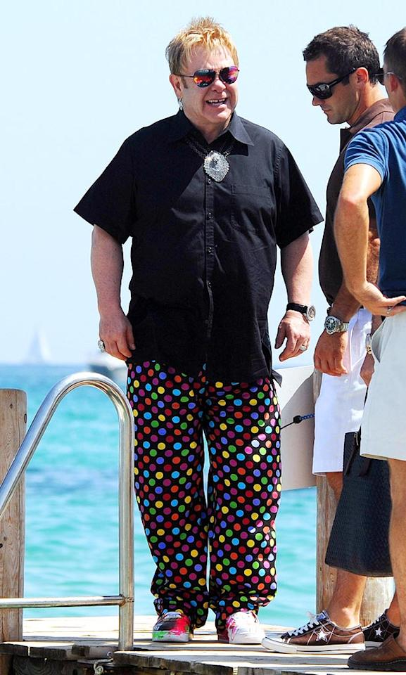 """We expect to see scary ensembles on Elton John, but we are truly terrified by those polka dot pants and that chainmail necklace. <a href=""""http://www.x17online.com"""" target=""""new"""">X17 Online</a> - August 7, 2008"""