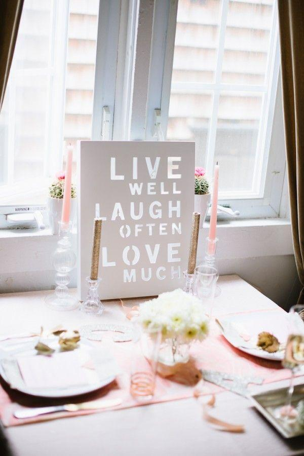 "<p>If you've been itching to break out a cliché ""live, laugh, love"" art print, now's the one time you can get away with it. Integrating the art into a centerpiece is a cinch to do and makes for a fun take on romantic decorating.</p><p><em>Via <a href=""http://theglitterguide.com/2013/02/12/a-romantic-valentines-day-at-home/"" rel=""nofollow noopener"" target=""_blank"" data-ylk=""slk:Glitter Guide"" class=""link rapid-noclick-resp"">Glitter Guide</a> </em></p><p><a class=""link rapid-noclick-resp"" href=""https://go.redirectingat.com?id=74968X1596630&url=https%3A%2F%2Fwww.etsy.com%2Flisting%2F772035653%2Flive-laugh-love-mini-stamped-book-set%3Fga_order%3Dmost_relevant%26ga_search_type%3Dall%26ga_view_type%3Dgallery%26ga_search_query%3Dlive%2Blaugh%2Blove%26ref%3Dsr_gallery-1-23%26organic_search_click%3D1&sref=https%3A%2F%2Fwww.elledecor.com%2Flife-culture%2Ffun-at-home%2Fg2387%2Fvalentines-day-decor%2F"" rel=""nofollow noopener"" target=""_blank"" data-ylk=""slk:GET THE LOOK"">GET THE LOOK</a><em><br>Live Laugh Love Mini Stamped Book Set, Etsy, $18</em></p>"