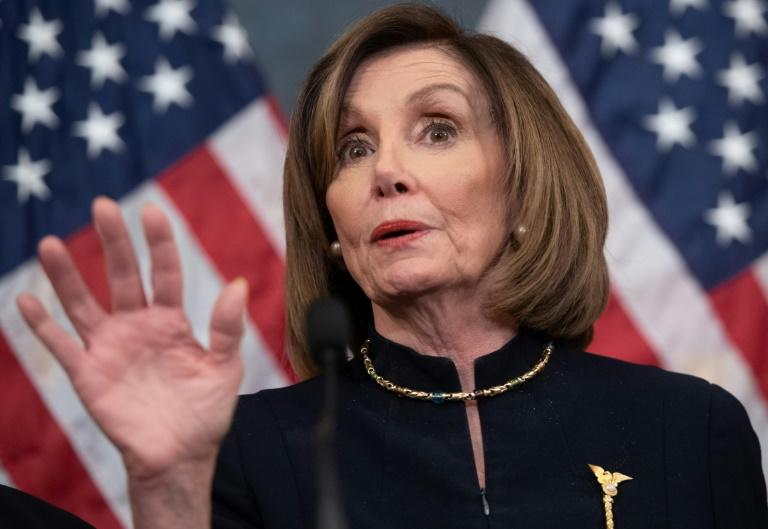"House Speaker Nancy Pelosi accuses Republicans int he Senate of attempting a ""cover-up"" with their proposed rules for the Senate trial of President Donald Trump (AFP Photo/SAUL LOEB)"