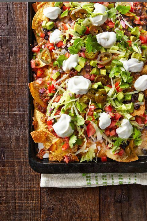 """<p>If there aren't nachos at the party, the Super Bowl can't happen. </p><p><a href=""""http://www.countryliving.com/food-drinks/recipes/a41067/friday-night-loaded-nachos/"""" rel=""""nofollow noopener"""" target=""""_blank"""" data-ylk=""""slk:Get the recipe from Country Living »"""" class=""""link rapid-noclick-resp""""><em>Get the recipe from Country Living »</em></a><br></p>"""