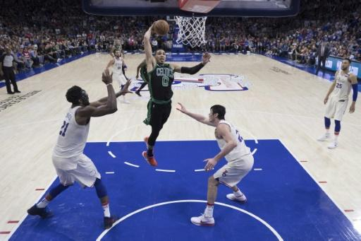 Jayson Tatum of the Boston Celtics goes up to dunk as the Celtics beat Philadelphia 101-98 in overtime to seize a 3-0 lead in the second-round series