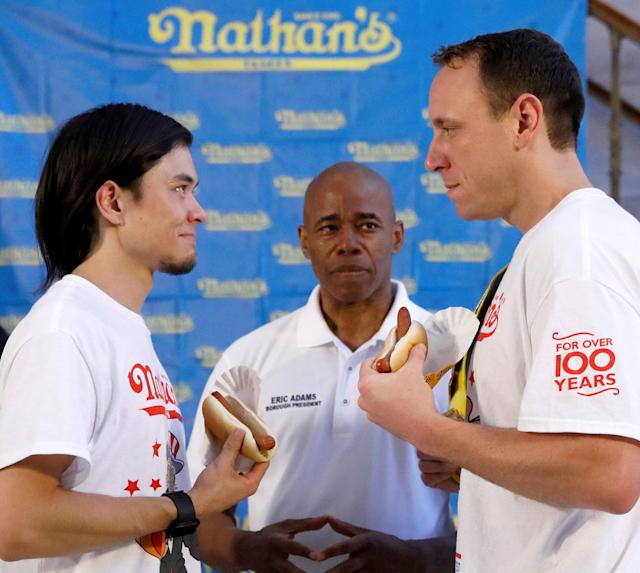 <p>Current world record holder Joey Chestnut (R) stares down with top contender Matt Stonie during the official weigh-in ceremony for the Nathan's Famous Fourth of July International Hot Dog Eating Contest in Brooklyn, New York City, U.S., July 3, 2017. (Brendan McDermid/Reuters) </p>