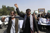"""Afghas shout slogans during an anti-Pakistan demonstration, near the Pakistan embassy in Kabul, Afghanistan, Tuesday, Sept. 7, 2021. The framed sign in Persian reads, """"Freedom."""" (AP Photo/Wali Sabawoon)"""