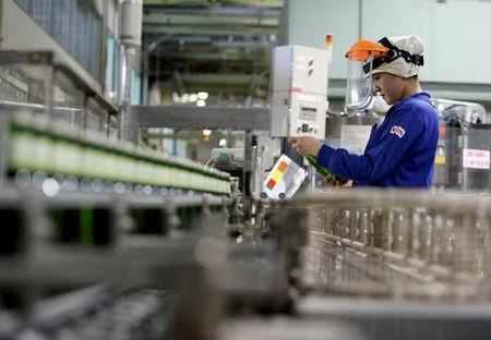 FILE PHOTO: Employee works at Japanese brewer Kirin Holdings' factory in Toride