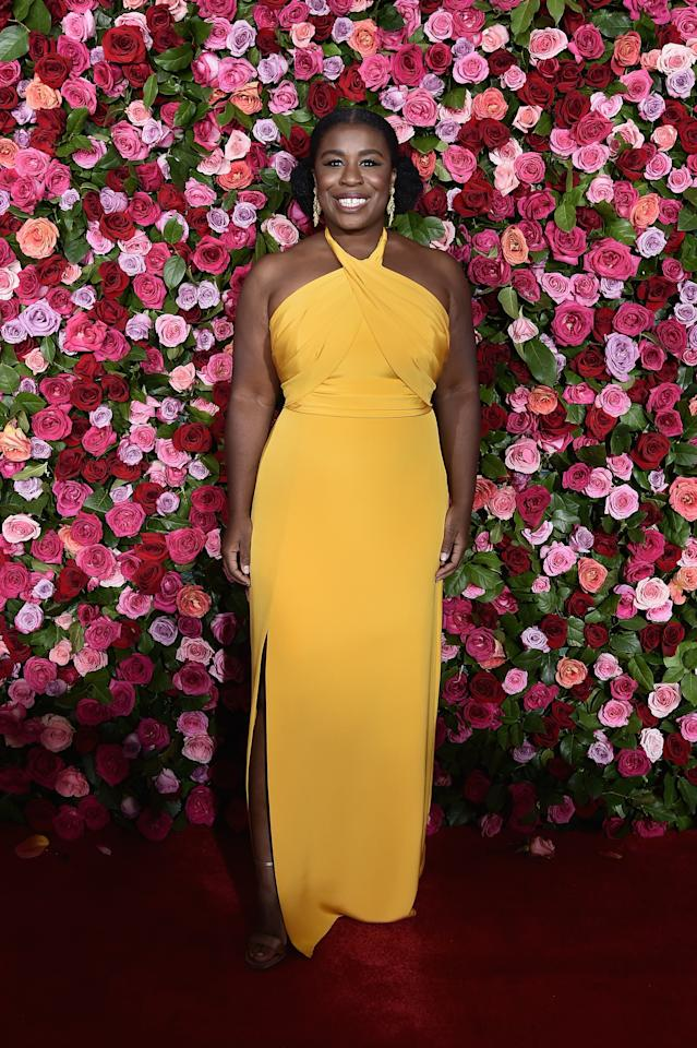 <p>Uzo Aduba wears a bright orange gown designed by Lorraine Schwartz. Source: Getty </p>