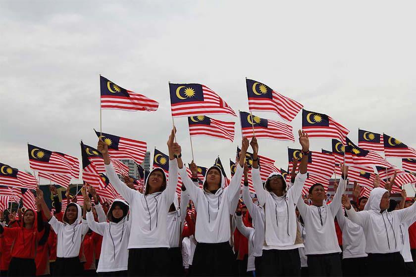A student waves a Malaysian flag during the rehearsal for Merdeka Day celebrations at Dataran Merdeka, Kuala Lumpur, August 28, 2014. — Picture by Yusof Mat Isa