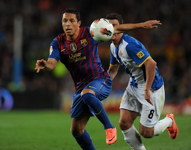 Barcelona's midfielder Thiago Alcántara vies with Espanyol's forward Alvaro Vazquez Garcia during the Spanish league football match FC Barcelona vs RCD Espanyol on May 5, 2012 at the Camp Nou stadium in Barcelona. AFP PHOTO/LLUIS GENELLUIS GENE/AFP/GettyImages
