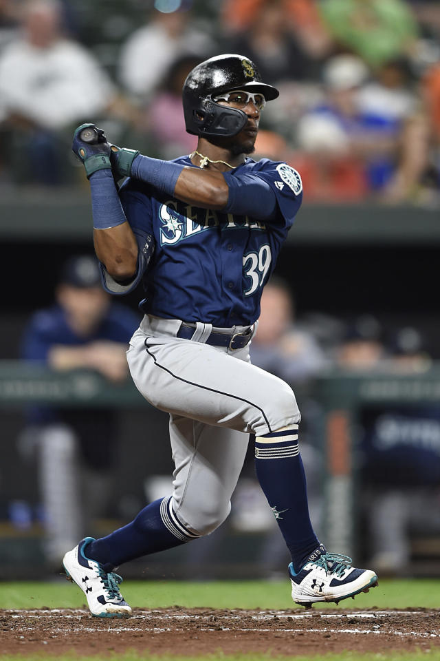 Seattle Mariners Shed Long follows through on a double against the Baltimore Orioles in the fifth inning of a baseball game, Saturday, Sept. 21, 2019, in Baltimore. (AP Photo/Gail Burton)