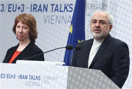 European Union foreign policy chief Catherine Ashton (L) and Iranian Foreign Minister Mohammad Javad Zarif deliver a press statement after a conference in Vienna February 20, 2014. REUTERS/Heinz-Peter Bader