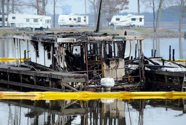 PHOTO: The charred remains of a boat are shown following a fatal fire at a Tennessee River marina in Scottsboro, Ala., on Jan. 27, 2020. (Jay Reeves/AP)