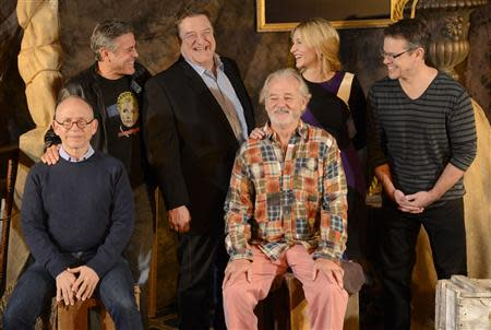 """Cast members Bob Balaban, George Clooney, John Goodman, Bill Murray, Cate Blanchett, Matt Damon and Grant Heslov are pictured during a photo call for the film """"The Monuments Men"""" held in Beverly Hills, California"""