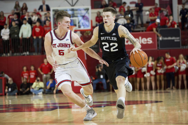 Butler forward Sean McDermott (22) us defended by St. John's guard David Caraher (5) during the first half of an NCAA college basketball game Tuesday, Dec. 31, 2019, in New York. (AP Photo/Julius Constantine Motal)