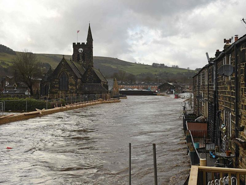 New flood defences in West Yorkshire failed to prevent a river bursting its banks at the weekend: AFP/Getty