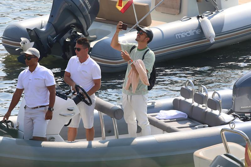 Orlando Bloom takes a selfie as he cruises into Ibiza.