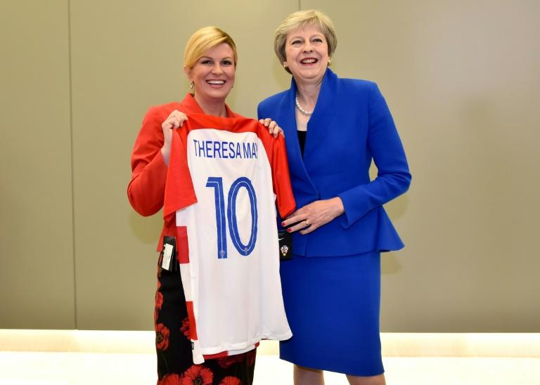 The Croatian president gave British Prime Minister Theresa May a number 10 jersey hours before England play Croatia in the World Cup semi-final