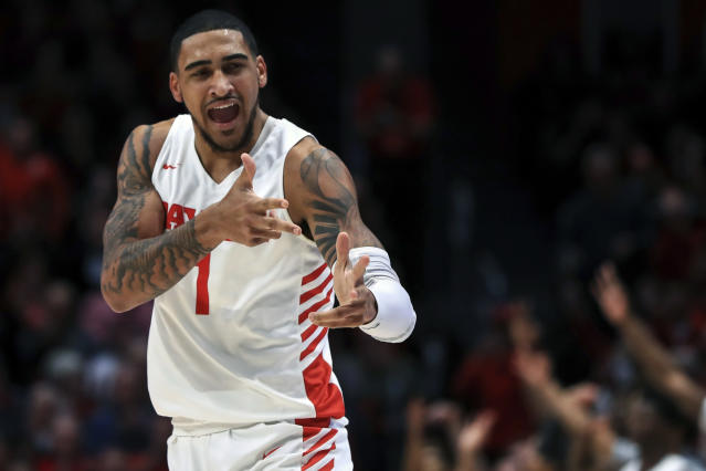 FILE - In this Feb. 11, 2020, file photo, Dayton's Obi Toppin (1) reacts in the first half in an NCAA college basketball game against Rhode Island in Dayton, Ohio. Toppin was selected to The Associated Press All-America first team, Friday, March 19, 2020. (AP Photo/Aaron Doster, File)