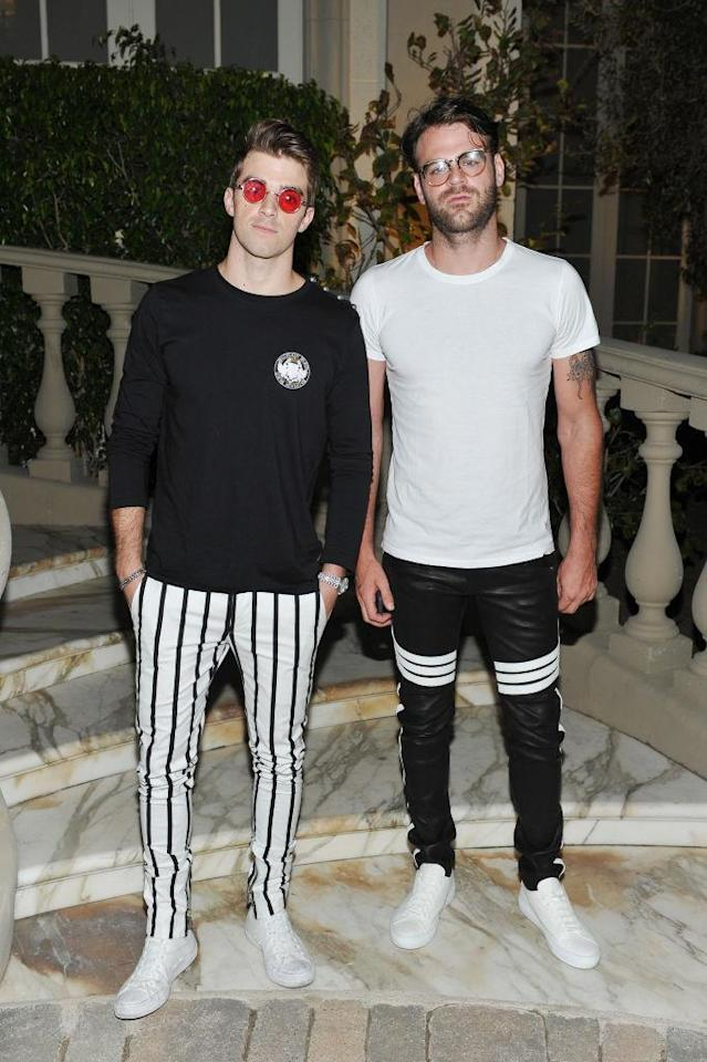<p>Andrew Taggart (L) and Alex Pall coordinated their outfits with striped pants and opposite color schemes. (Photo by Donato Sardella/Getty Images for BALMAIN) </p>