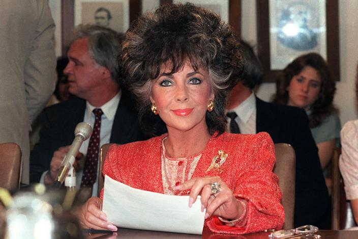 Elizabeth Taylor testifies before a Senate sub-committee on May 8, 1986 in Washington as chairman of the American Foundation for AIDS Research (amfAR).