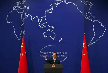 China's Foreign Ministry spokesman Hong asks journalists for questions during a news conference in Beijing