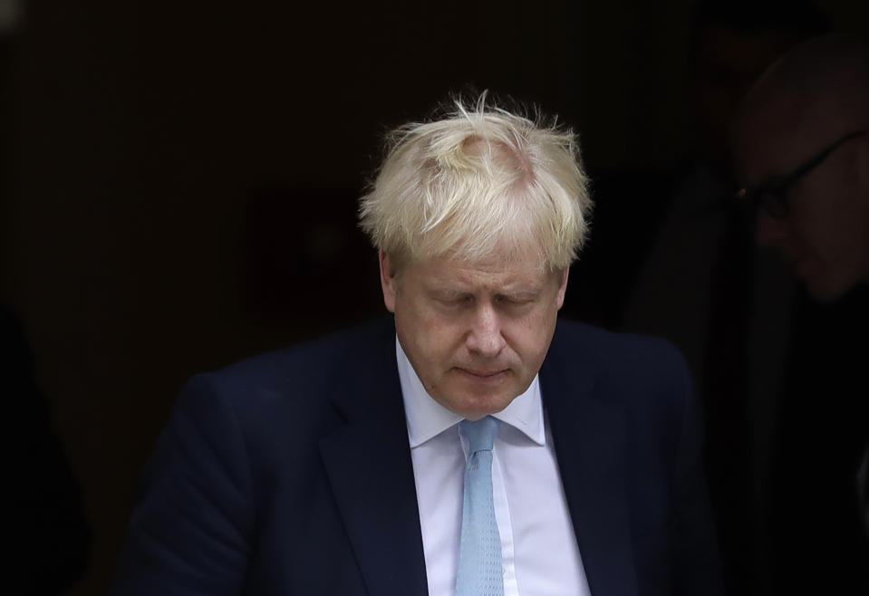 """Britain's Prime Minister Boris Johnson leaves Downing Street to attend Parliament in London, Thursday, Oct. 3, 2019. The U.K. offered the European Union a proposed last-minute Brexit deal on Wednesday that it said represents a realistic compromise for both sides, as British Prime Minister Boris Johnson urged the bloc to hold """"rapid negotiations towards a solution"""" after years of wrangling. (AP Photo/Kirsty Wigglesworth)"""
