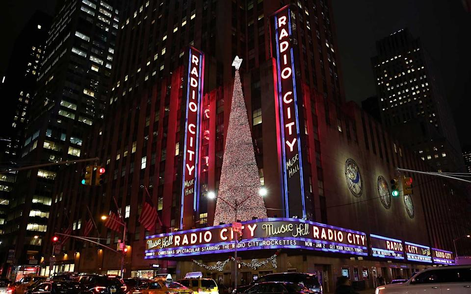 """<p>The Rockettes are a New York City institution, and they've been in more than a couple Christmas movies. Go see the <a rel=""""nofollow noopener"""" href=""""https://www.rockettes.com/christmas/"""" target=""""_blank"""" data-ylk=""""slk:Christmas Spectacular"""" class=""""link rapid-noclick-resp"""">Christmas Spectacular</a> at Radio City Music Hall, and you'll be participating in a decades-long tradition. </p>"""