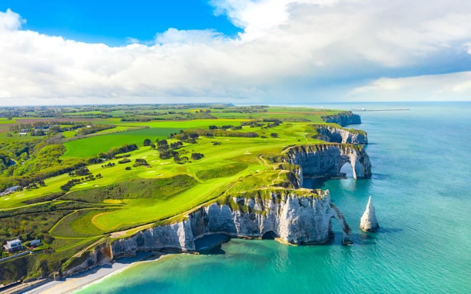 The coastline at Etretat in Normandy is worth seeing - istock