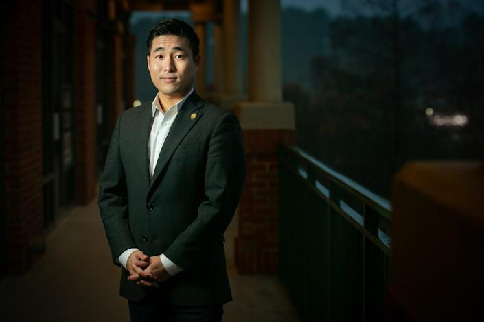 Georgia State Rep. Sam Park poses with hands clasped in front of him outside a Duluth, Ga., shopping center.