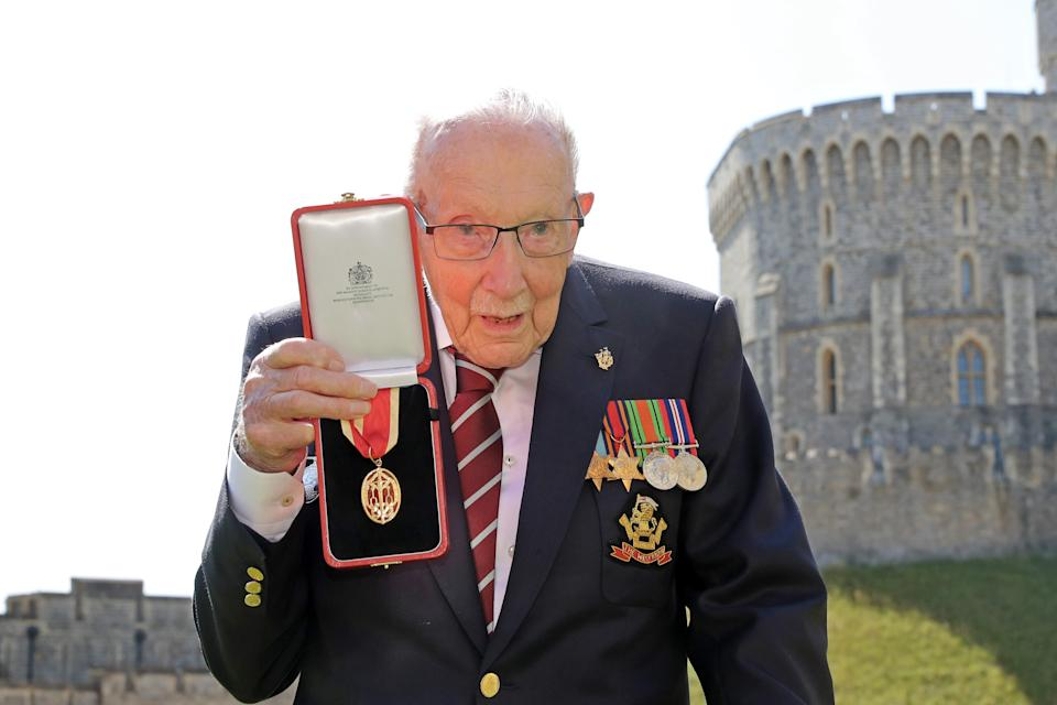 100-year-old WWII veteran Captain Tom Moore poses with his medal after being made a Knight Bachelor during an investiture at Windsor Castle in Windsor, west of London on July 17, 2020. - British World War II veteran Captain Tom Moore was made a a Knight Bachelor (Knighthood) for raising over £32 million for the NHS during the coronavirus pandemic. (Photo by Chris Jackson / POOL / AFP) (Photo by CHRIS JACKSON/POOL/AFP via Getty Images)